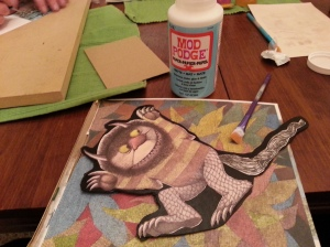 I used special paper modge podge to glue the wild thing to its background and then added a layer on top to seal it.
